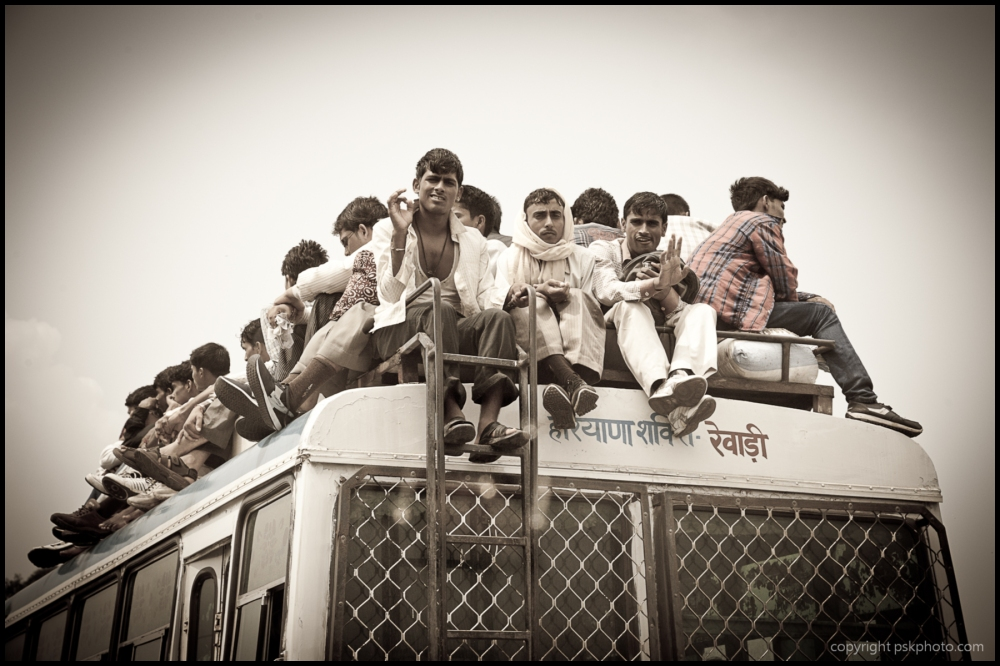 Roof passengers on Indian bus