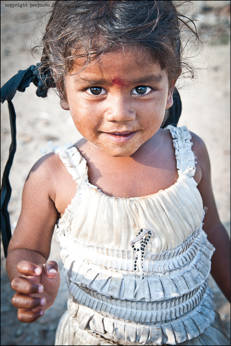 A small child living in a slum community just outside Hyderabad, India, 2013