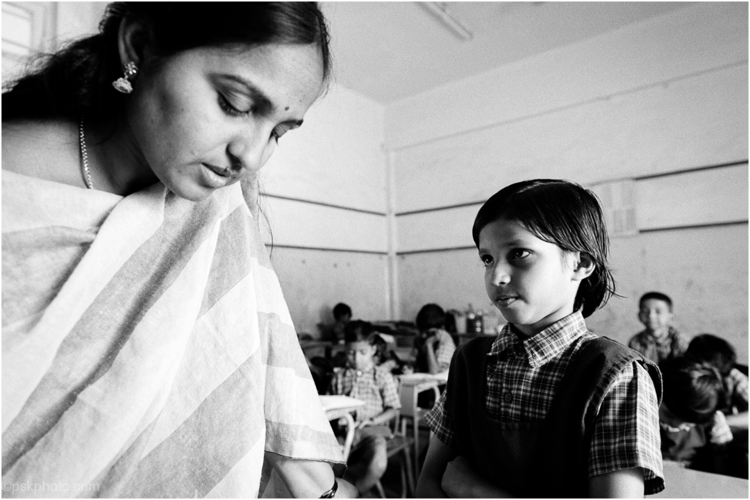 A child waits with slight anticipation for her marks. IDPL School, Telangana, India, 2014