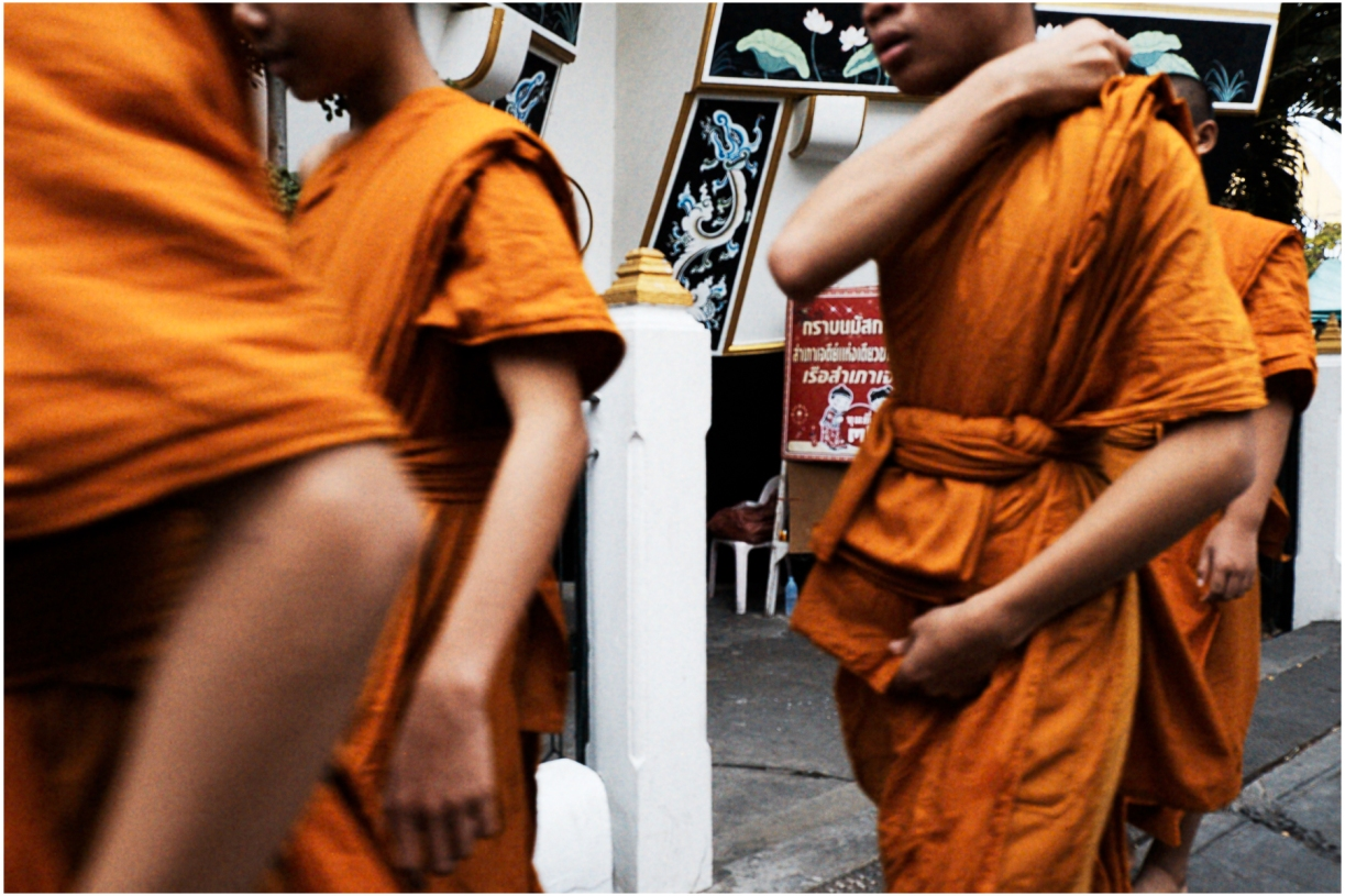 Young Buddhist Monks walk by at the Wat Yannawa Temple, Bangkok, 2015