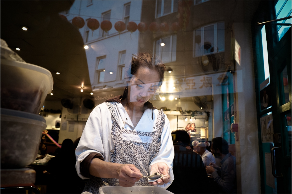 Shot through the window of a small cafe in London's Chinatown, a worker makes what I think might be dumplings (any corrections on this welcome) A fascinating late afternoon on Sunday, since it was the Moon Festival and the streets were packed. Please look out for my forthcoming post on this, shot entirely from chest level. Love Chinatown!