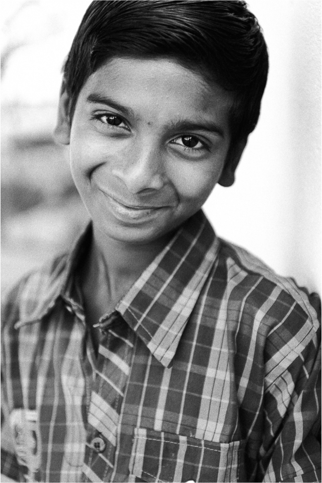"""I often find that what I love about India is its incredible diversity. It's usually the first thing visitors notice. Tine and time again I find that its greatest asset is its ordinary people. Happiness is a gift that this boy seems to possess. Maybe only for right now, but possess it he does. One of my favourite quotes; """"Realise deeply that the present moment is all you ever have."""" Eckhart Tolle"""