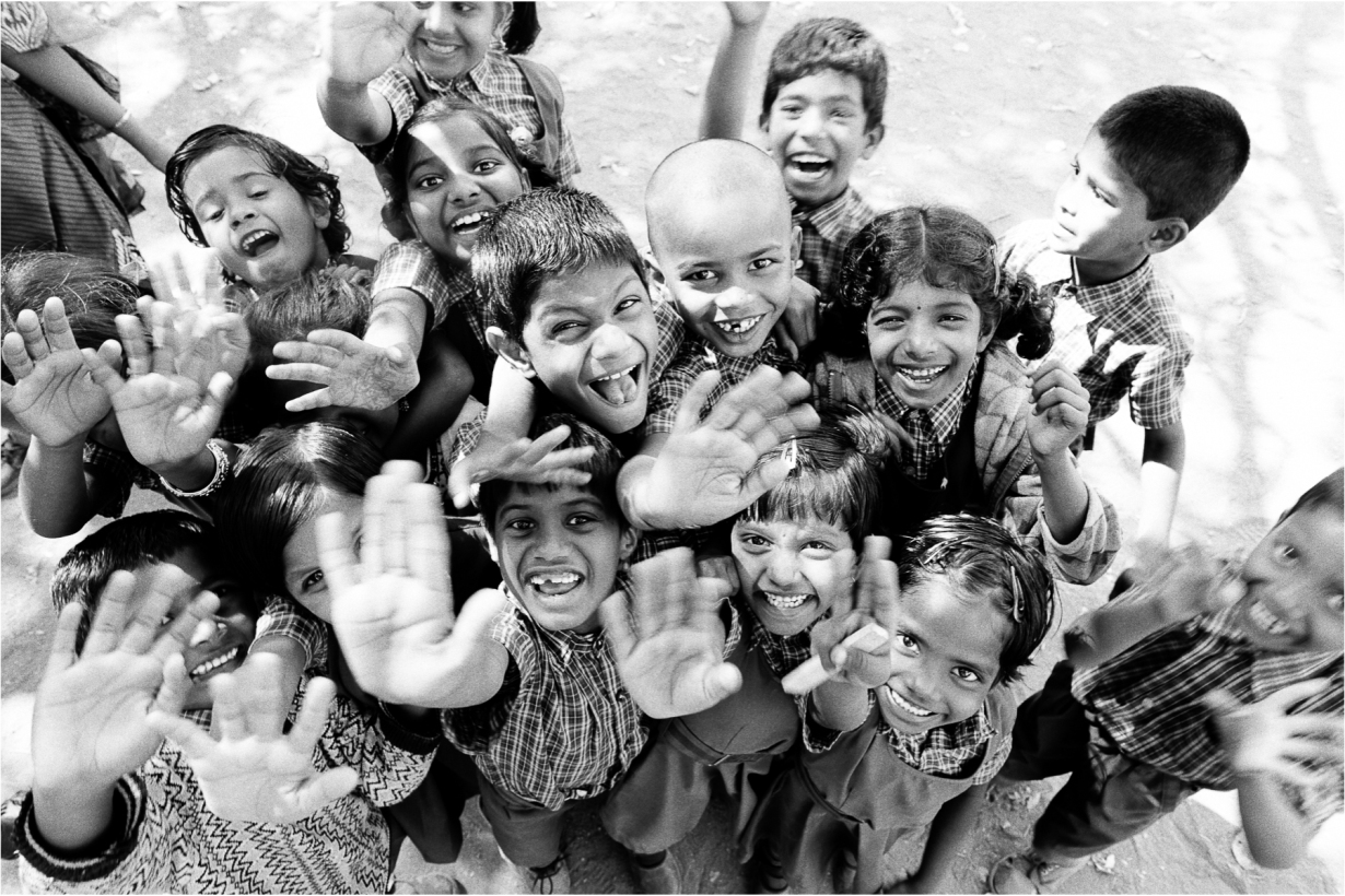 """The """"poor kids"""" happiness achieved not with smart devices, games consoles and an endless supply of toys. Just a bit of a laugh in the playground and the chance to jump around for photo op! Are we risking """"dumbing down"""" our """"developed world"""" children with screens?"""
