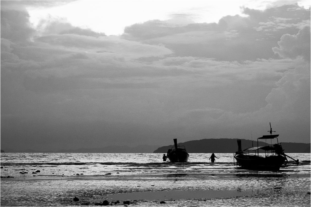 """Very short on """"me time"""" during a recent trip to Thailand, I did manage to sit for a while here at the end of a tiring day. These are Longtail boats returning from excursions,mooring  to let passengers off. Andaman Sea, South Thailand, 2015"""